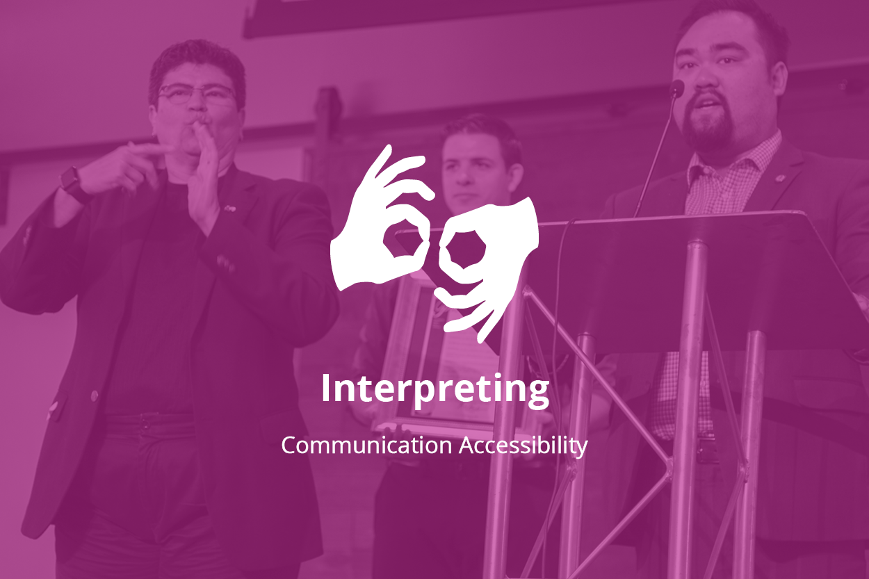 "Background photo of a speaker at a podium, an interpreter next to him and a person standing in the middle. Forefront: a logo with two hands shaped as F's, singing ""interpret"". Text: Interpreting, communication accessibility."